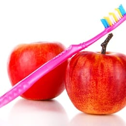 Two apples and a toothbrush