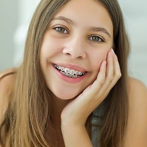 Smiling young woman with braces