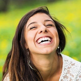 Laughing young woman outdoors