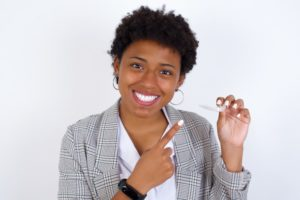 woman holding removable retainer